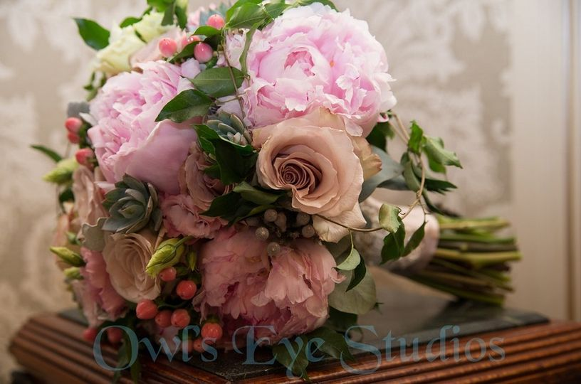 Bridesmaids bouquets which contained gorgeous Peonies, Lisianthus, and Hypericum just to name a few....