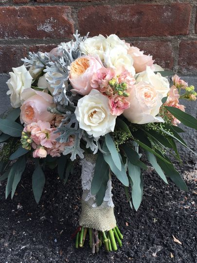 This super pretty, rustic bouquet has Juliet Garden Roses, apricot colored Stock Flower, Dusty...