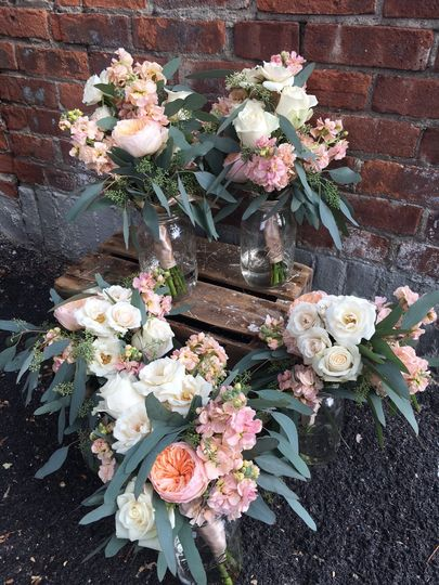 Gorgeous bridesmaids bouquets with Juliet Garden Roses, apricot colored Stock Flower, Dusty Miller,...