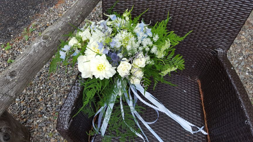 This beautiful summer bouquet contains Dahlias, Roses, Delphinium, and Wildflowers.