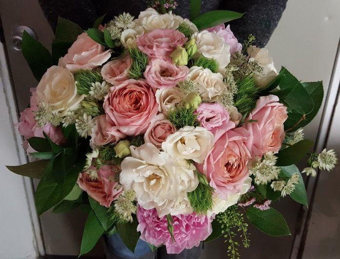 This classic style bouquet with Peonies, Garden Roses, Pennycress, and Astrantia is a really pretty...