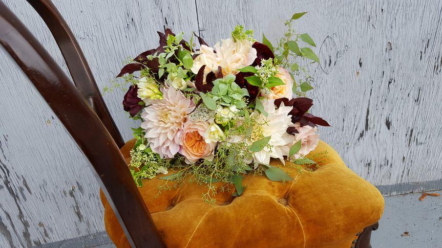 This gorgeous bouquet has a vast array of flowers including Dahlias, peach Garden Roses,...