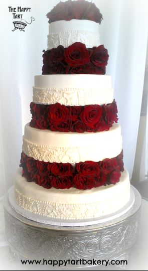 fondant wedding cake with brocade lace and floating tiers