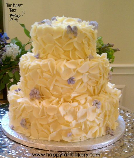 white chocolate curls and crystalized lilacs and violets wedding cake