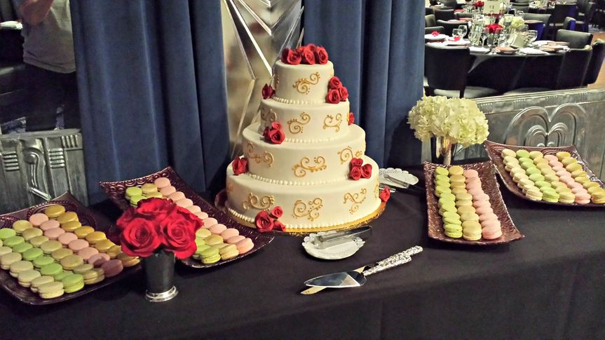 wedding cake and macarons dessert tabl