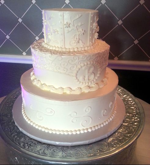 Gluten free buttercream wedding cake with lace piping and monogram