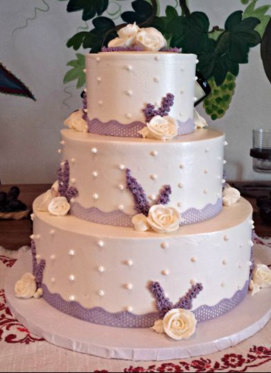 buttercream wedding cake with purple lace ribbon p
