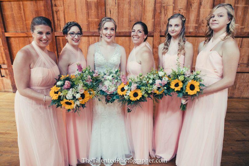 Ladies holding bouquets
