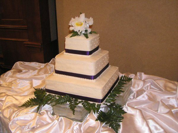Simple, tailored, elegant.  Ask about ways we can help keep the cake cost within your budget.