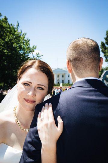 Hugging her groom