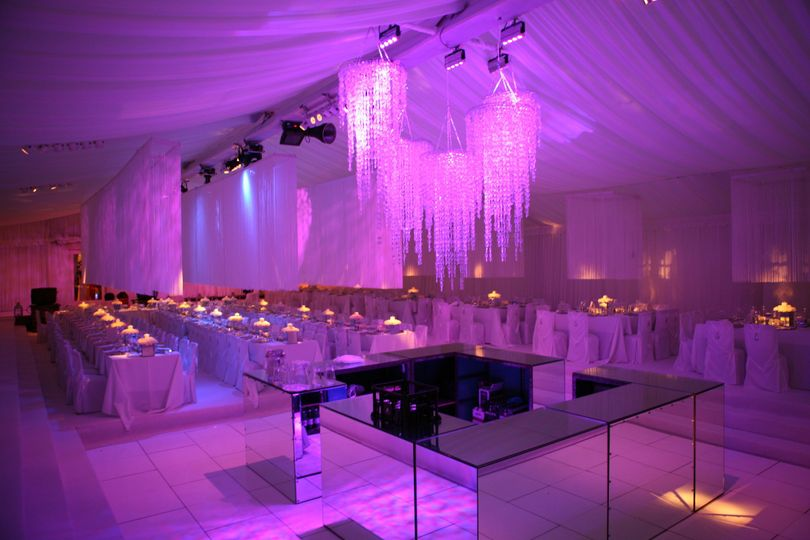 Stunning lighting effects and chandeliers in a marquee wedding reception