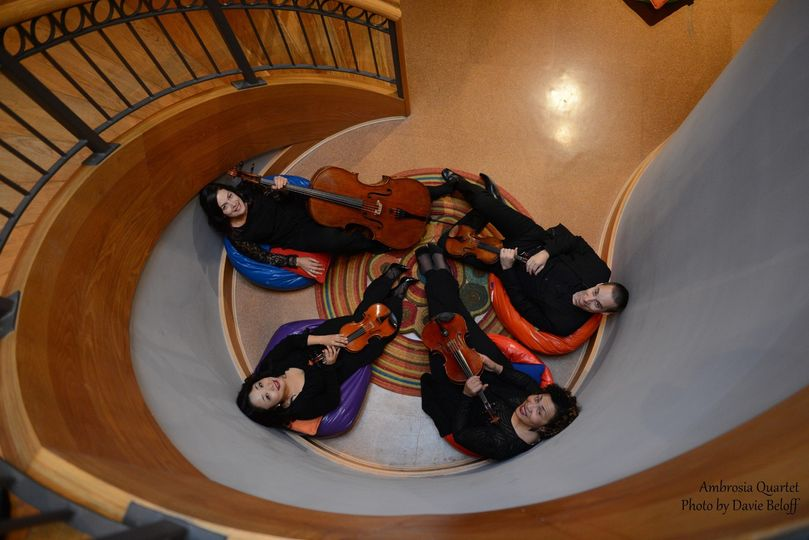 The ensemble seated at the foot of stairs