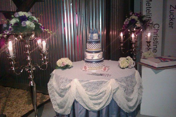 Freestanding silver candelabra were used at both the ceremony and reception and are enhanced with...