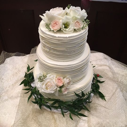 Textured cake with rose decorations