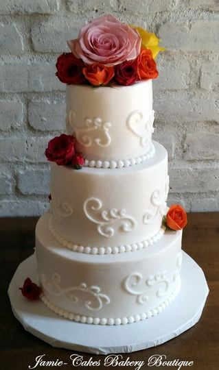 White cake with rose toppers