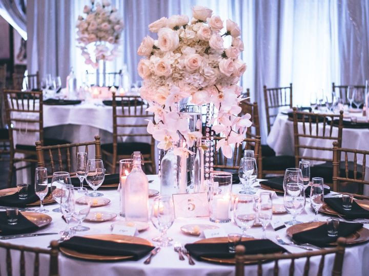 Tmx Pink And White Roses Centerpiece On Top Of Table 1616113 51 133546 159121597388949 Floral Park, NY wedding florist