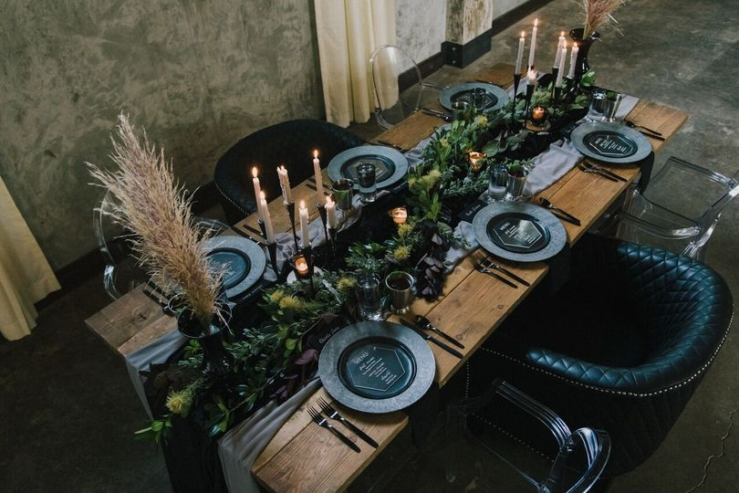 Table with candles and foliage