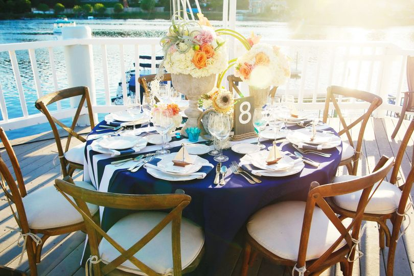 Round table setting with flowers centerpiece