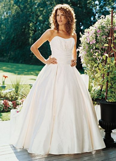 This beautiful crisp dupioni ball gown comes in Blush, Ivory or White. The bodice is rusched for an...