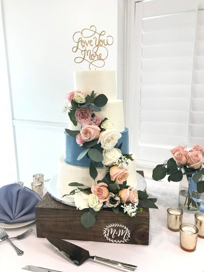 Floral wedding cake with blue tier
