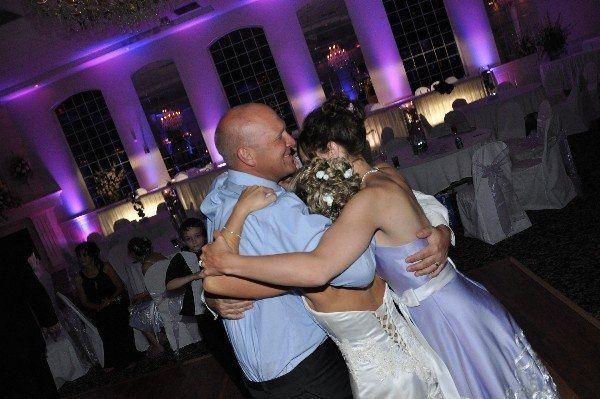 Couple and bridesmaid's group hug