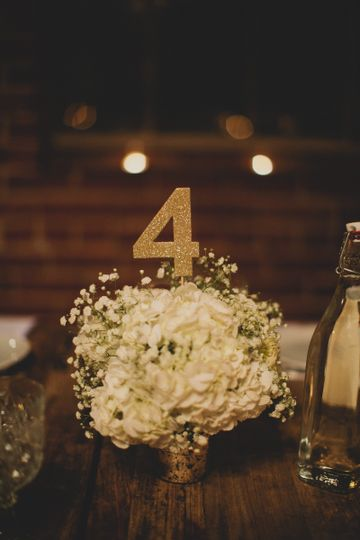 Simple and chic petite centerpiece utilizing silver mercury glass, white hydrangea and babys breath...