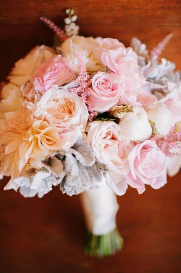 Gorgeous blush and white bridal bouquet designed with dahlias, garden roses, peonies, roses, alstibe...