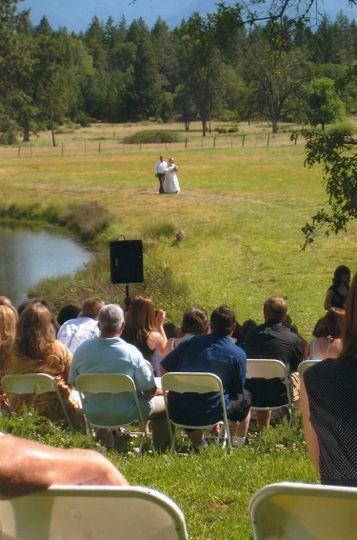 Bride approaching Wedding Garden