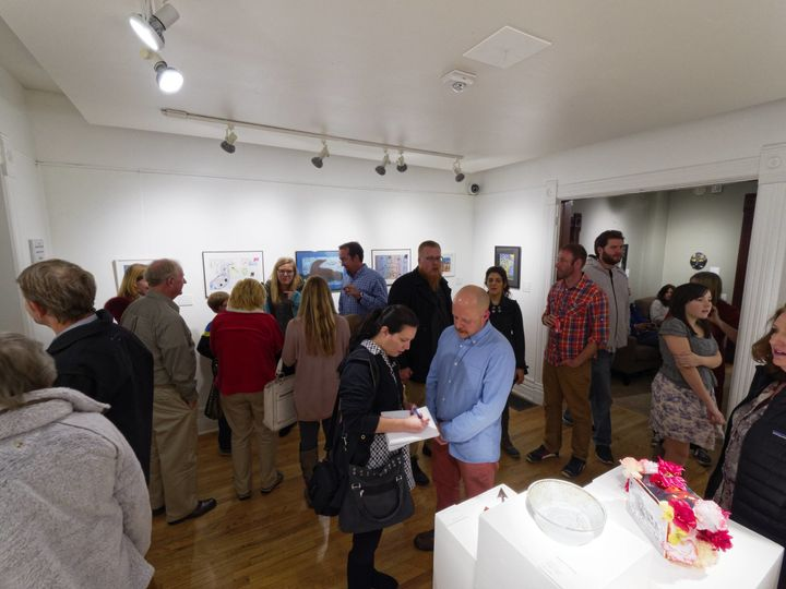 Inside gallery north during an opening supporting local students