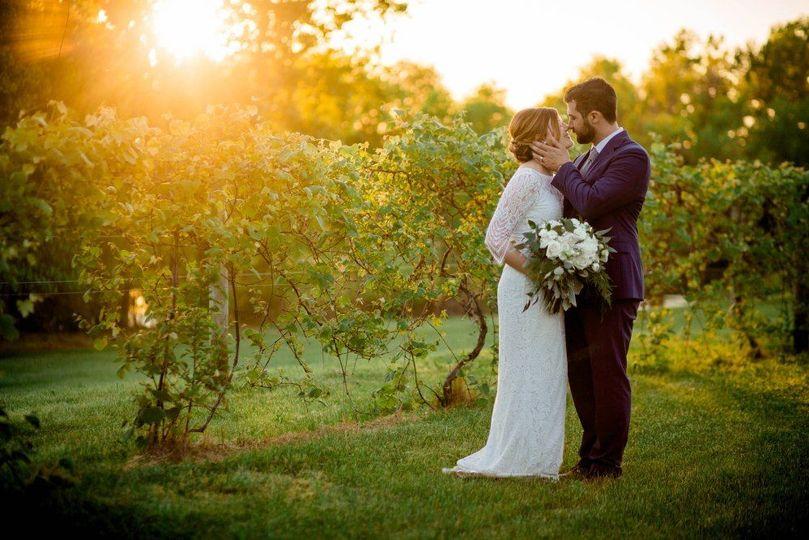 Newlyweds by the greenery