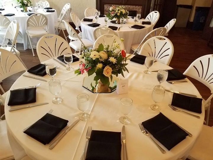 Black napkins and floral centerpiece