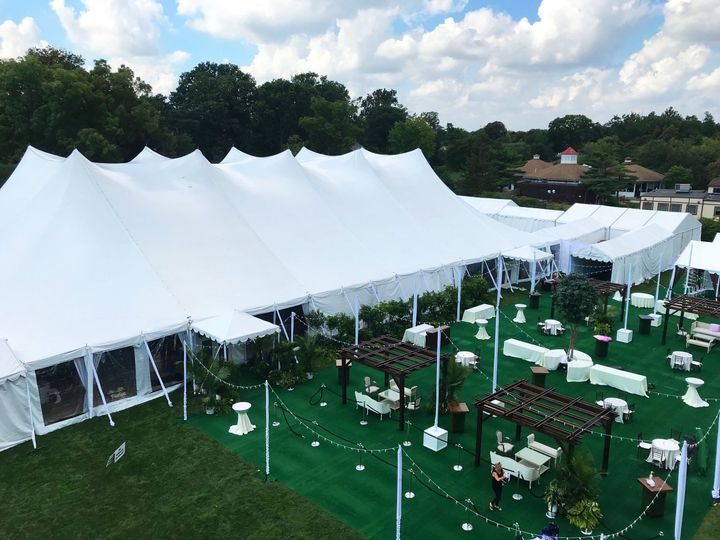 Tented and outdoor reception setup