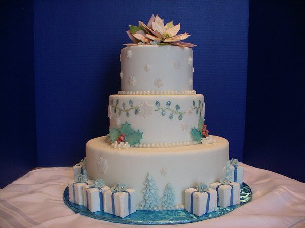 Holiday cake covered in white fondant with gumpaste and pastillage decorations.  Entirely edible!...