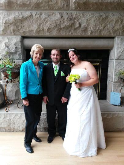 Pastor Deb Helton with the newlyweds