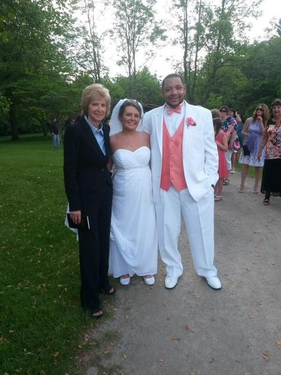 Pastor Deb Helton with the bride and groom