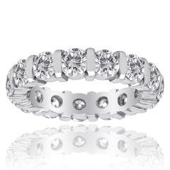 Diamond Eternity Ring in 14k white gold. 3.18 tw.   This clearly vibrant eternity band features 15...