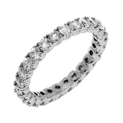 Diamond eternity ring in 14k white gold. 1.40   This vibrant and gentle eternity band features 26...