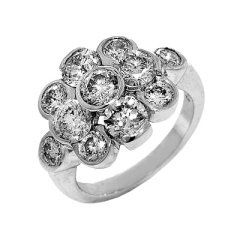 Diamonds Fashion Ring, 3.96ct.   11 round brilliant cut of various sizes are set in a way to give...