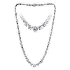 18k white gold graduate riviera necklace , 9.05ct   This elegant 18k white gold necklace features...