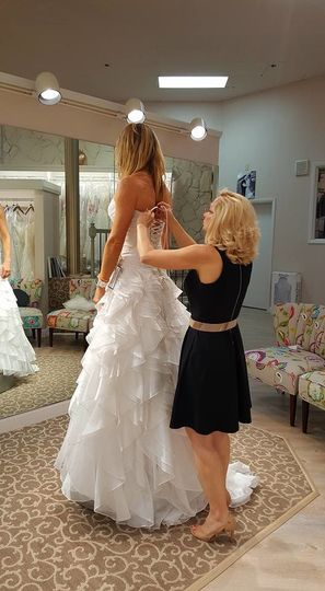 Assisting the bride with the dress