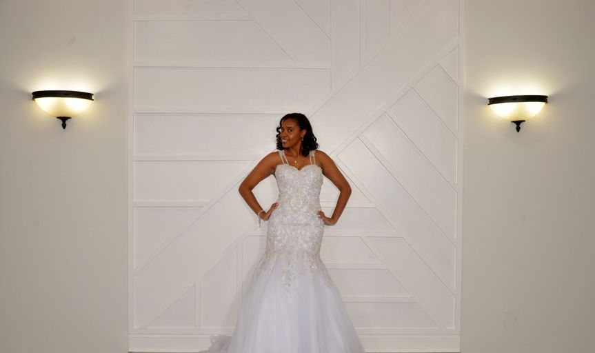 Bride in front of accent wall