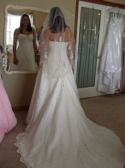 Jocelyn's bridal gown alterations - we added the custom corset-back, re-designed the neckline,...