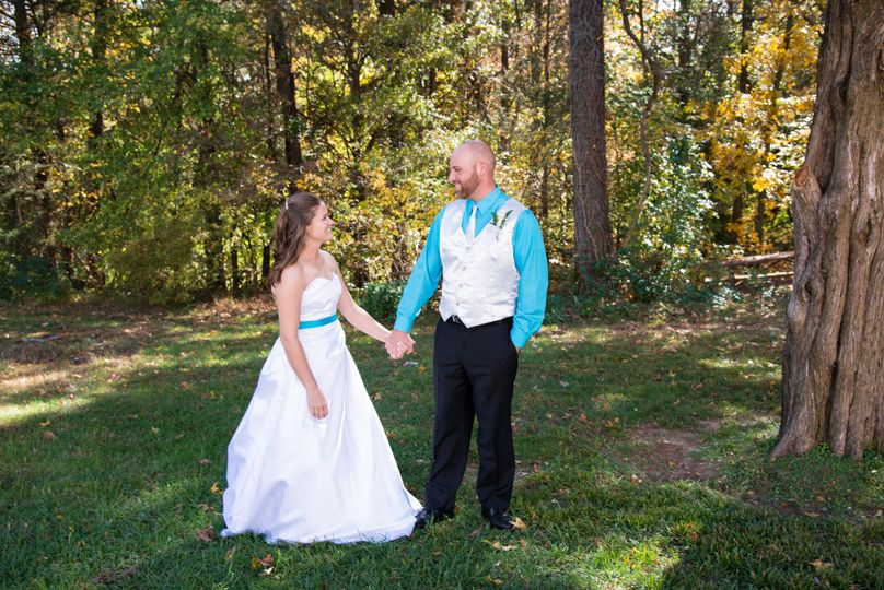 Custom bridal gown and groom's vest and tie