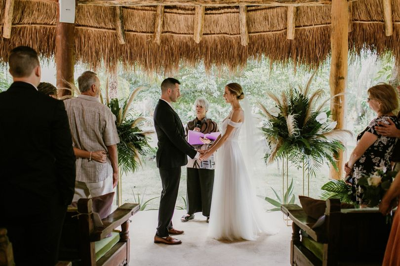 Exchanging vows under palapa