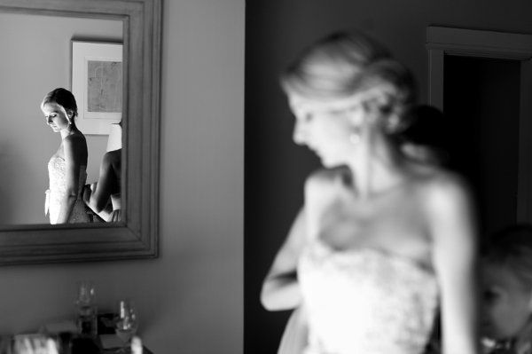 Siobhan getting ready in her dress by monique lhuillier