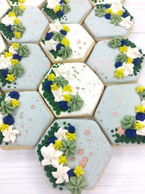 Hexagon cookies with a touch of whimsy, for a spring wedding dessert table.