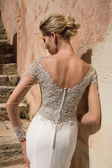 Beaded sleeved bridal gown