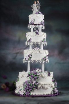 A traditional style cake that has cascading petunias and roses.  Small lace points hang from the...