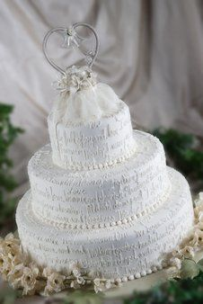 Personalize your cake!  A three tiered cake covered in words of love.  Use your vows, a favorite...