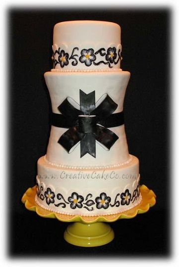Double carved barrel cake with black bow and brushed embroidery